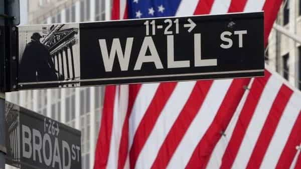 FILE PHOTO: The Wall Street sign is pictured at the New York Stock exchange (NYSE) in the Manhattan borough of New York City (REUTERS)