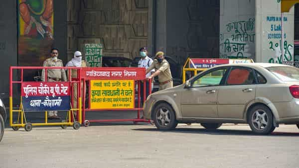 UP Police check authority passes of commuters at Delhi-Noida border (PTI)