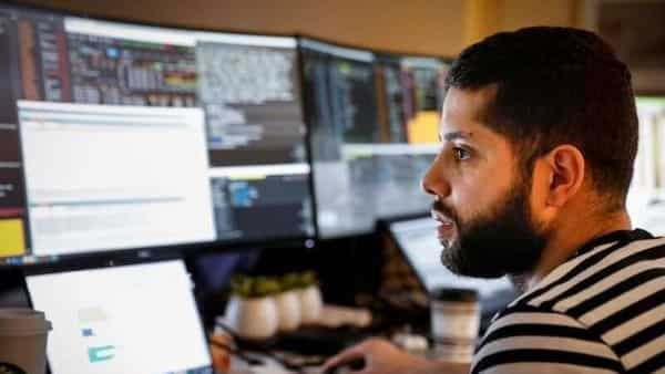 FILE PHOTO: NYSE-AMEX Options floor trader Luis from TradeMas Inc.works in an off-site trading office built when the New York Stock Exchange (NYSE) closed, due to the outbreak of the coronavirus disease (COVID-19), in the Brooklyn borough of New York City, U.S. (REUTERS)