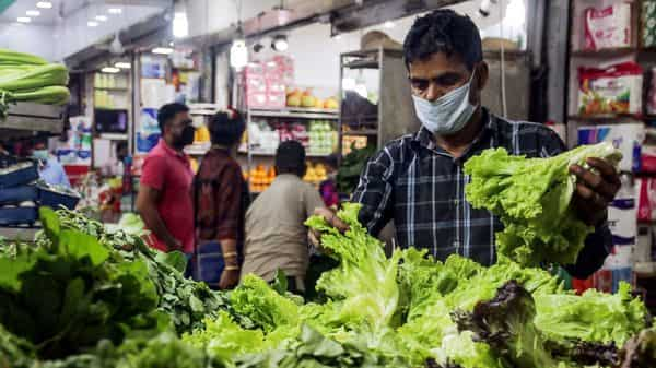 People wear mask during shopping at a grocery shop amid rising cases of COVID 19 Novel Coronavirus in New Delhi. (ANI )