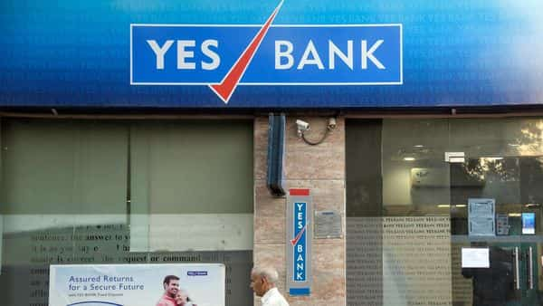 A man walks past Yes Bank which resumed its service from yesterday, at Sarojini Nagar, in New Delhi on Thursday. (ANI Photo)