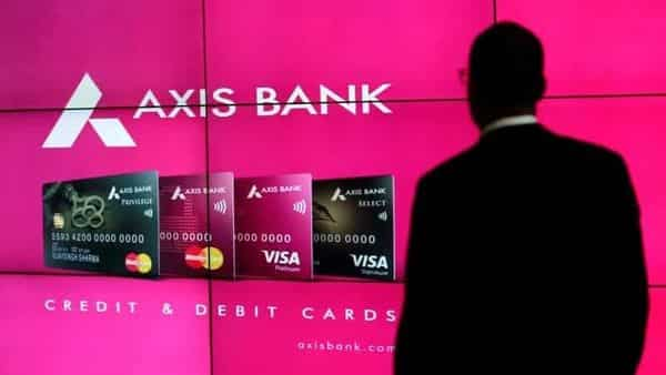A visitor watches an Axis Bank's advertisement at its corporate headquarters in Mumbai, July 25, 2017. REUTERS/Danish Siddiqui/Files