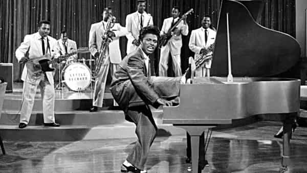 1956: Musician Little Richard performs onstage with his band in 1956. (Photo by Michael Ochs Archives/Getty Images)