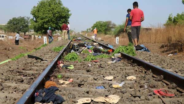 The belongings of 16 migrant workers who were run over by a goods train lie scattered on the tracks. reuters