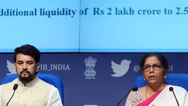 Union Finance Minister Nirmala Sitharaman and Minister of State for Finance Anurag Singh Thakur address a press conference, in New Delhi on Friday.  (Photo: ANI)