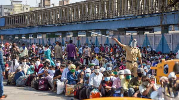 Mumbai: Migrants arrive at Bandra Terminus to board a special train to Jaunpur(UP) arranged by Maharashtra government, during the ongoing nationwide COVID-19 lockdown, in Mumbai, Wednesday, May 13, 2020. (PTI)
