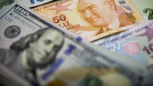 Turkish lira and U.S. dollar banknotes sit on display in this arranged photograph in Istanbul, Turkey,  (Bloomberg)