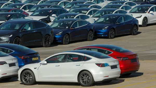 New electric automobiles, manufactured by Tesla Inc., sit on the dockside after being imported to the Port of Southampton in Southampton, U.K., (Bloomberg)