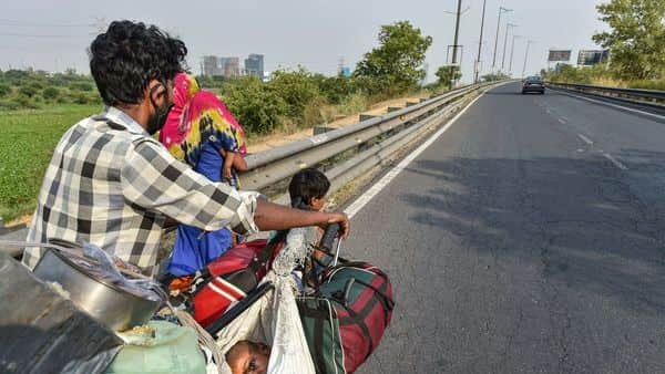 A migrant family walk towards their native place in UP, during the ongoing COVID-19 nationwide lockdown, in New Delhi. (PTI)