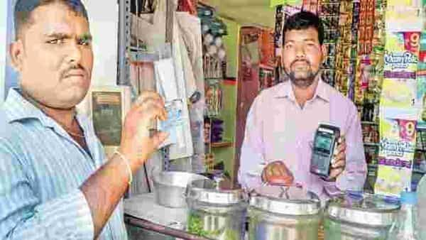 A file photo of a man using his Rupay debit card to pay for purchases at a store at Ibrahimpur. Photo: Yunus Y. Lasania/Mint