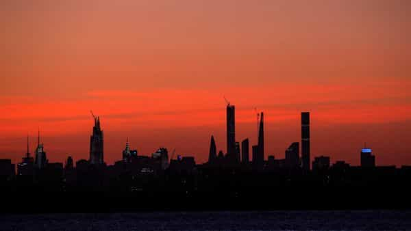 The midtown Manhattan skyline is seen shortly after sunset, during the outbreak of the coronavirus disease. (REUTERS)