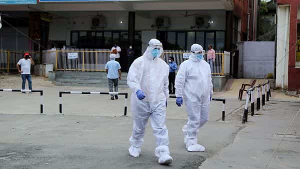 Medical Health officials wearing PPE suits going to conduct health checkups. (ANI)
