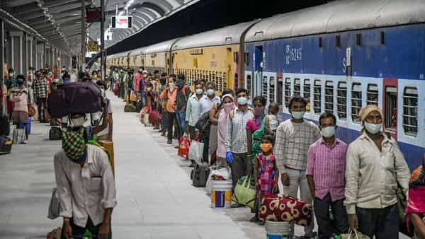 Migrants arrive at a railway station via special trains arranged for them from Telangana. (PTI)