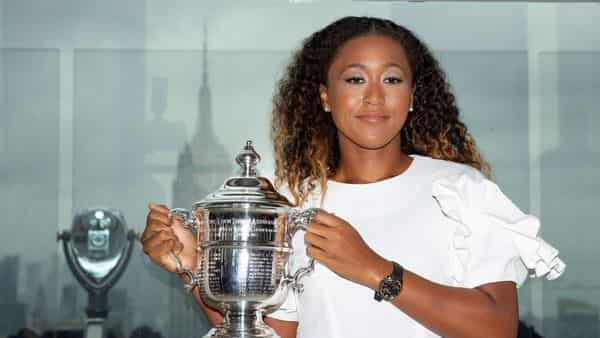 (File photo) Naomi Osaka of Japan poses with the championship trophy (Reuters)