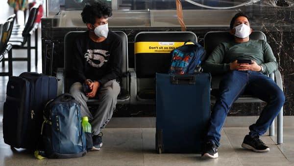 Passengers wearing face masks maintain social distance at Indira Gandhi International (IGI) airport, (REUTERS)