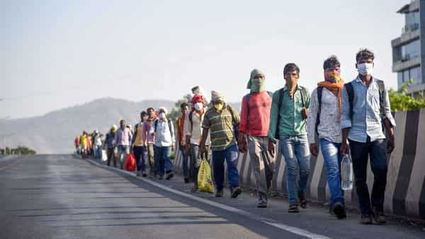 Migrants from Jharkand, who were stranded in Raigad district of Maharashtra, walk along a road towards their native place during the ongoing nationwide covid-19 lockdown, in Navi Mumbai. (Photo: PTI)