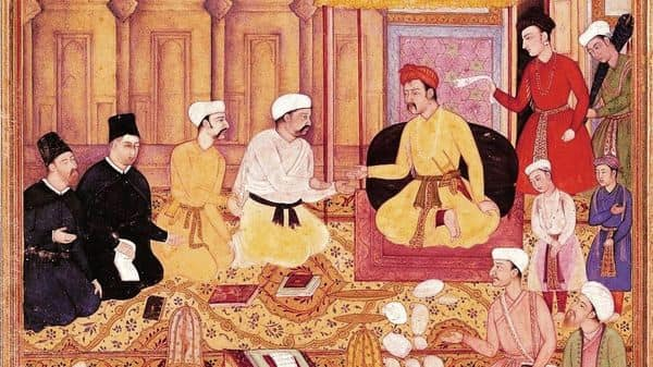 Ira Mukhoty; and (above) Akbar in conversation with Jesuit missionaries, in a 16th century Mughal School miniature painting. (Photo: Getty Images)