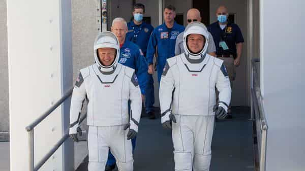 NASA astronauts Douglas Hurley (L) and Robert Behnken at NASA's Kennedy Space Center ahead of NASA's SpaceX Demo-2 mission ( REUTERS)