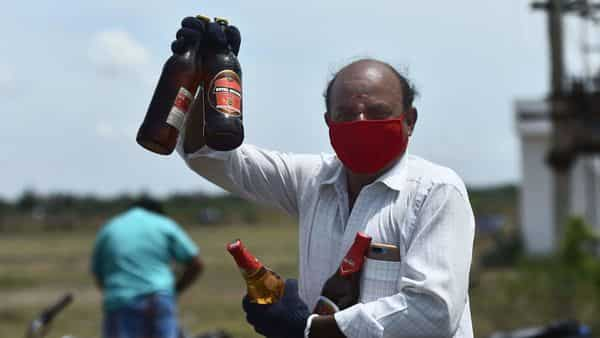 A man shows liquor after buying them. (PTI)
