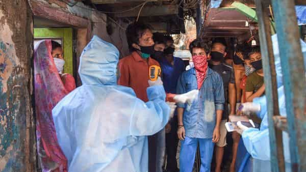 Mumbai: Health workers wearing protective suits screen the residents of Naik Nagar during a house-to-house health survey, after detection of some COVID-19 positive cases, during the nationwide lockdown, at Dharavi in Mumbai, Wednesday, May 6, 2020. (PTI Photo) (PTI)