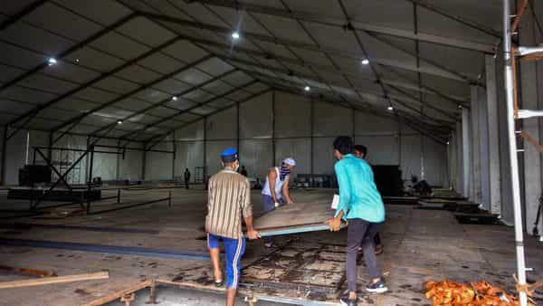 Mumbai: Workers carry material to build a quarantine and hospital facility for treating critical COVID-19 patients, at RTO Kandarpada in Mumbai, Thursday, June 4, 2020. Reportedly, the center is set to be fully air-conditioned and will accomodate 250 beds with ICU's and dialysis facilities. (PTI Photo) (PTI)