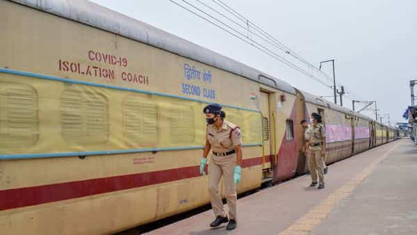 RPF personnel inspect a train coach which has been modified into a COVID-19 Isolation Coach. (PTI)