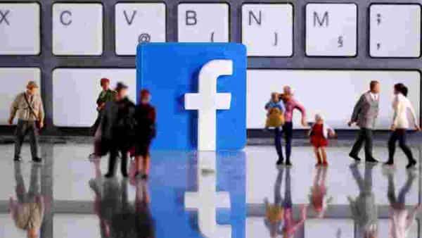 FILE PHOTO: A 3D printed Facebook logo is placed between small toy people figures in front of a keyboard (REUTERS)