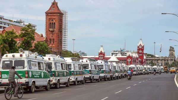 Ambulances are parked in front of the Victoria Public Hall building in Chennai, where coronavirus cases are surging. (PTI)