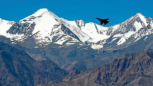An Indian fighter jet flies over a mountain range near Leh, the capital of the Union territory of Ladakh, on Monday.