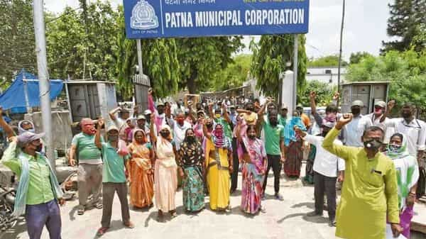 Patna Municipal Corporation employees at a strike demanding the payment of delayed salaries. In the coming months, states are likely to receive significantly lower central revenues than what they budgeted for. (Photo: Santosh Kumar/Hindustan Times)