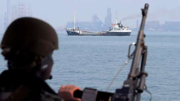 FILE PHOTO: A U.S. Navy soldier onboard Mark VI Patrol Boat stands guard as an oil tanker makes its way towards Bahrain port (REUTERS)