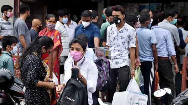 People rush to market buy essential goods after declared complete lockdown for 14-days starting from June 28, due to surge in COVID-19 cases, in Guwahati on Friday. (ANI Photo)