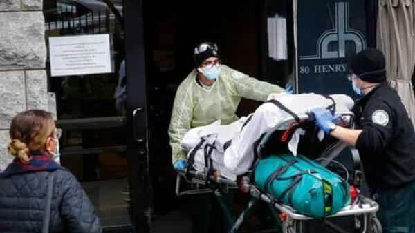 A patient is wheeled into Cobble Hill Health Center by emergency medical workers in the Brooklyn borough of New York. (AP)
