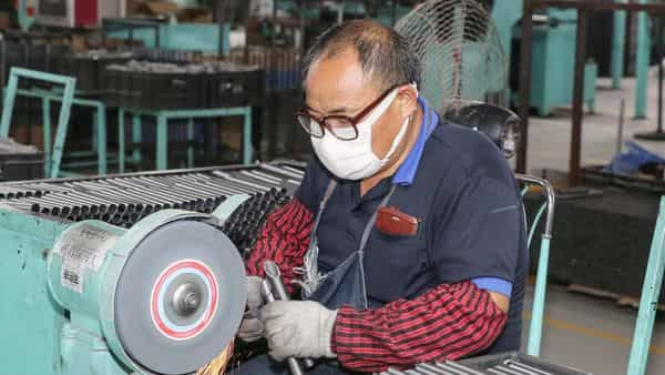 This photo taken on June 9, 2020 shows an employee working at a factory in Haian in China's eastern Jiangsu province (AFP)
