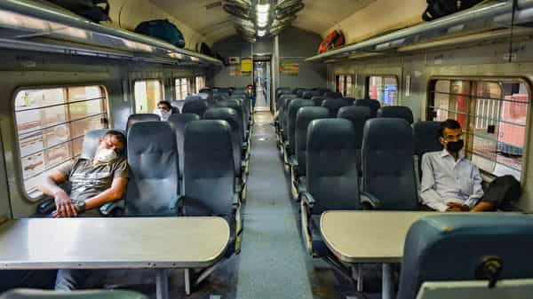 Passengers sit in a coach of a special train leaving for New Delhi  (PTI)