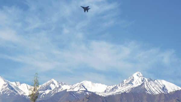 A fighter jet flies from an Indian Air Force base above the Himalayas in Leh on Wednesday. (PTI)