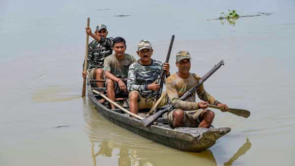 Morigaon: Forest guards patrol at Pobitora Wildlife Sanctuary following flooding in the low-lying areas, in Morigaon district of Assam,  (PTI)