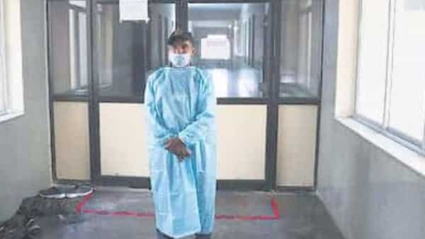 A medic outside a Covid-19 isolation ward at the Gandhi Hospital in Hyderabad on Monday. The man from Telangana, who contracted the disease, was admitted to this hospital on Sunday (Photo: AP)
