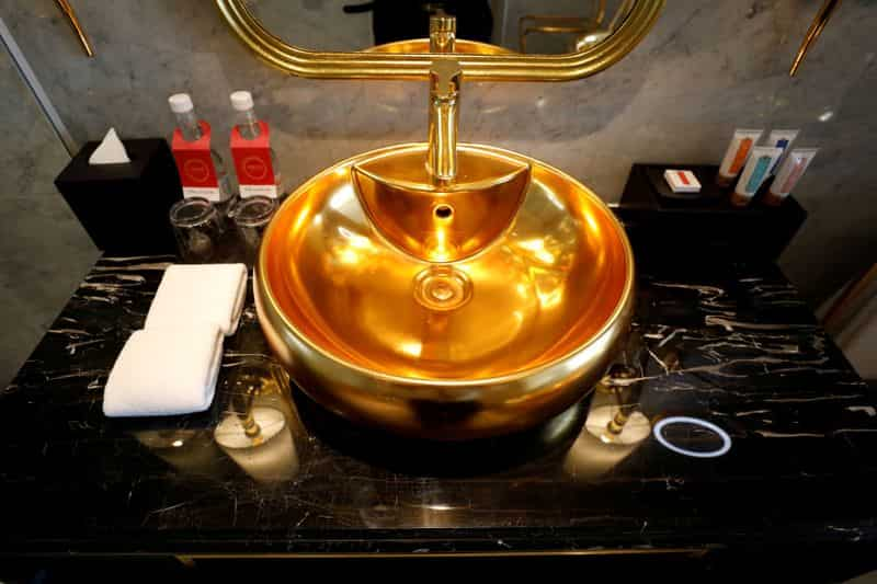 A gold-plated bathroom sink is seen in the newly inaugurated Dolce Hanoi Golden Lake luxury hotel.