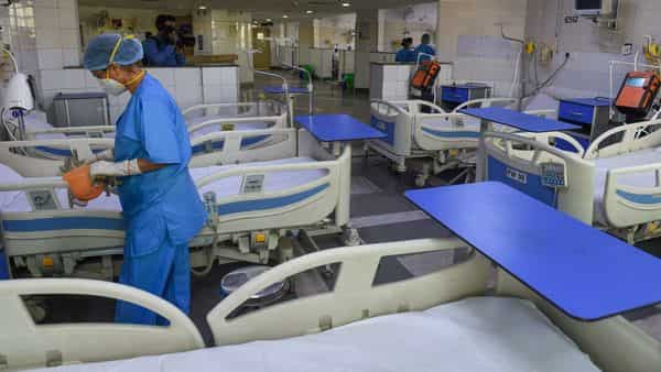 Medics make arrangements in a new COVID-19 isolation ward at the Rajiv Gandhi Super Specialty Hospital in New Delhi (PTI)