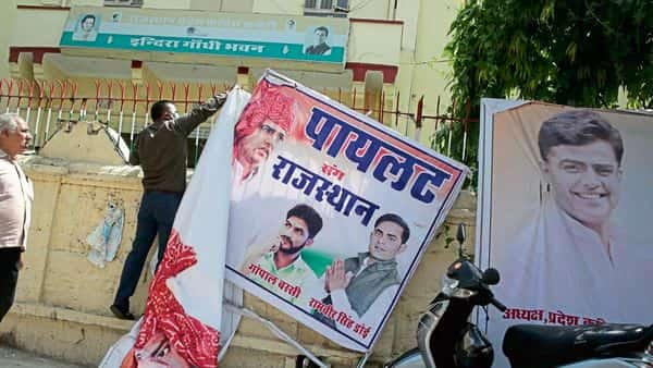 Banners of Sachin Pilot being pulled down at the state Congress office in Jaipur on Tuesday. (Himanshu Vyas/HT)