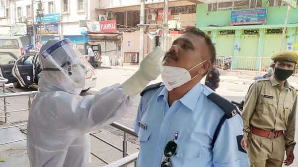 A medic collects a nasal sample for COVID-19 test, at fancy Bazaar in Guwahati. (ANI)