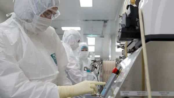A scientist controls parameters of product diafiltration process during the research and development of a vaccine against the coronavirus disease (COVID-19) at a laboratory of BIOCAD biotechnology company in Saint Petersburg, Russia. (REUTERS)