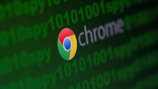FILE PHOTO: Google Chrome logo is seen near cyber code and words 'spy' in this illustration picture (REUTERS)