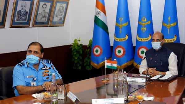 Defence Minister Rajnath Singh and IAF Chief RKS Bhaduaria during the inaugural session of the Air Force Commander's conference (ANI)