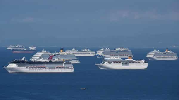 This file photo taken on May 31, 2020 shows a general view of cruise ships anchored at Manila Bay waiting for disembarkation clearance from authorities for their Filipino crews who have undergone swab tests for the COVID-19 coronavirus, (AFP)