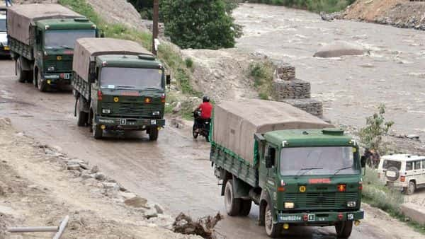 Army vehicles carrying military goods on Manali-Leh highway for Ladakh stationed, in Kullu. (ANI)