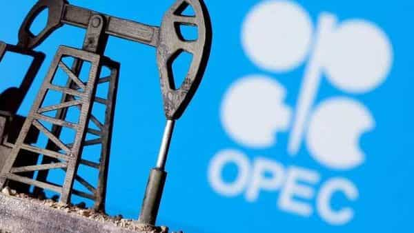 A 3D printed oil pump jack is seen in front of displayed Opec logo (REUTERS)