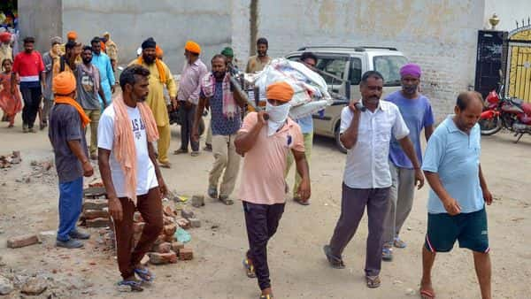 Villagers carry the body of Kirpal Singh, who died after allegedly consuming spurious liquor, for cremation at Mucchal village near Amritsar (PTI)