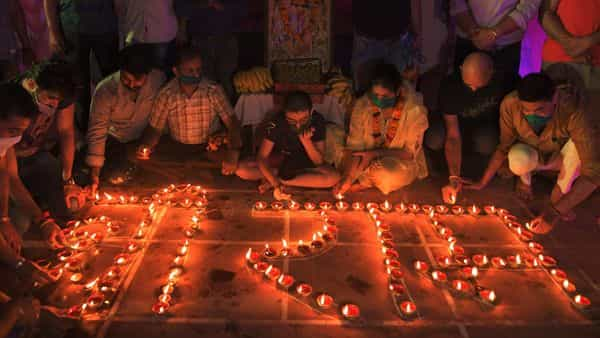 Hindu devotees light oil lamps forming the words 'Shri Ram' as they celebrate on the eve of groundbreaking ceremony of the proposed Ram Temple, in Ayodhya, (AFP)
